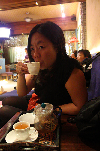 Drinking tea at the foot massage parlour